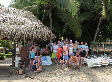 A group of KWEST members on a trip to a tropical climate.