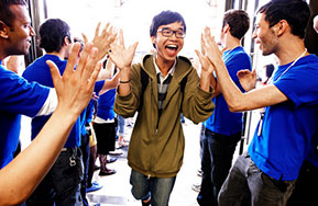 Photo of students high fiving