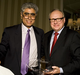 Interim Dean Sunil Chopra (left) with Alumni Service Award winner