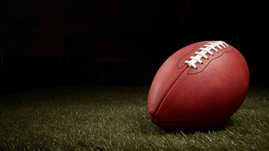 Can a football player's race affect how often he is penalized? Associate Professor Robert Livingston investigates.