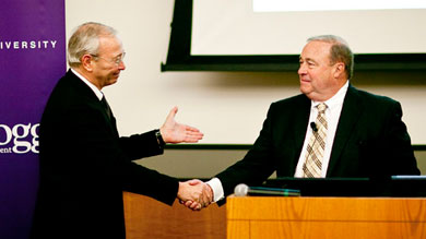 Bush Brothers CEO James B. Ethier (right) accepts the Kellogg Family Enterprise Leadership Award from John L. Ward, director of the Center for Family Enterprises.