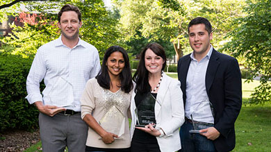 From left to right, Kellogg Leadership Award winners Collin West '12, Saloni Doshi '12, Shannon Holly '12 and Ben Hernandez '13