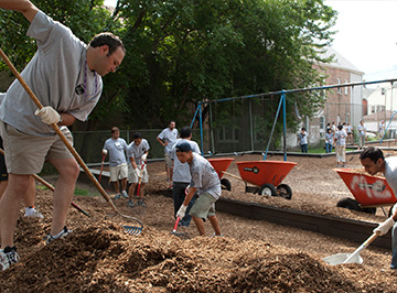 Volunteers help in landscaping a local park.